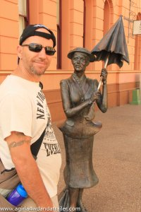 Hubby with the Mary Poppins statue next to the former Australian Joint Stock Bank