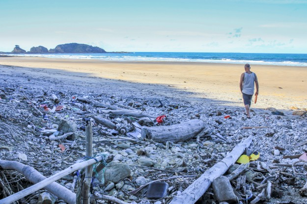 A sea of pumice and rubbish litters Little Five Rock Beach