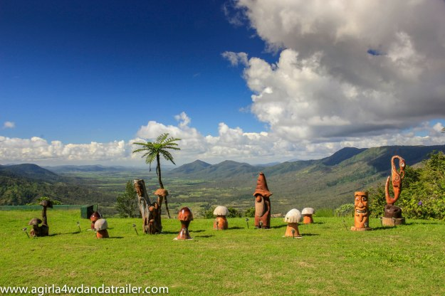 Wooden carvings on the lawn outside of Eungella Chalet